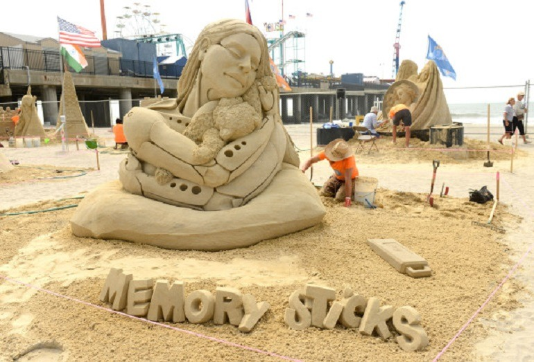 Image- Memory Sticks by Mélineige Beauregard and Jonathan Bouchard of Canada won the first place doubles competition at the World Championship of Sand Sculpting in Atlantic City. A great art contest/ art competition