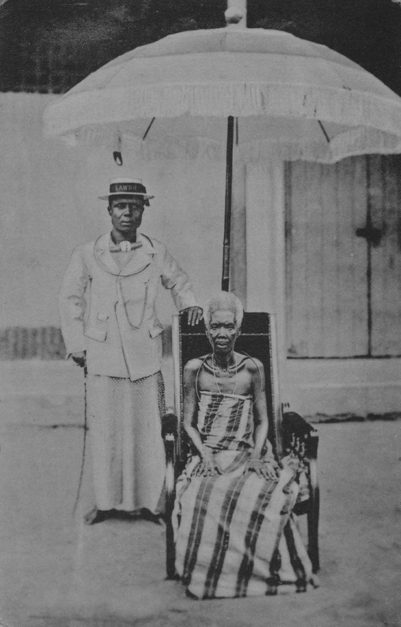 Image-man and his wife under the queens umbrellar shows the history of photography in Nigeria and how it was used by Nigerians to record history