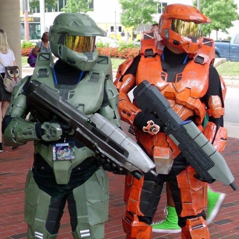 Image of robot soldiers with their guns ready for action at Otakon at the Baltimore Convention Center showing off to the audience