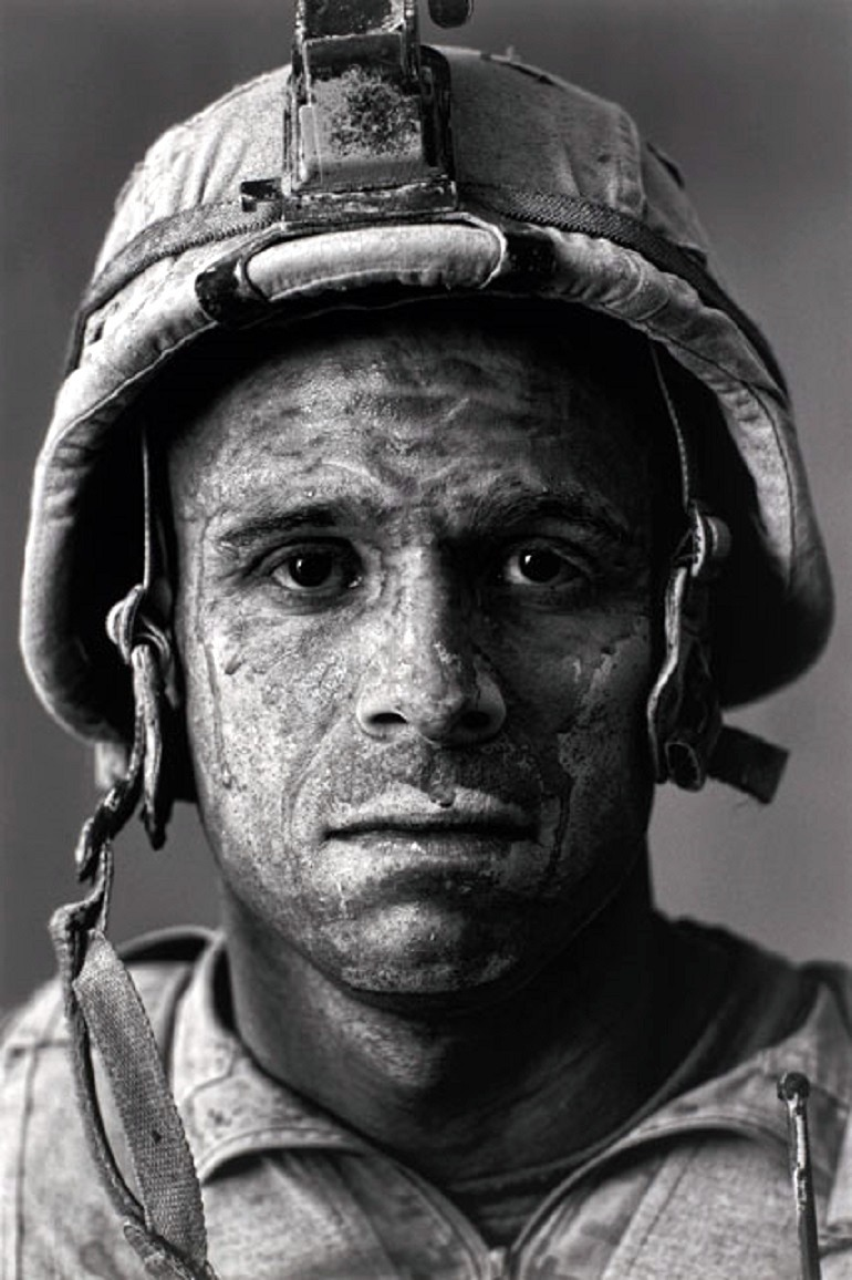 "Image: Photograph  by Louie Palu (Canadian, b. 1968) captures a  U.S. Marine Gysgt. Carlos ""OJ"" Orjuela, age 31, Garmsir District, Helmand Province, Afghanistan"