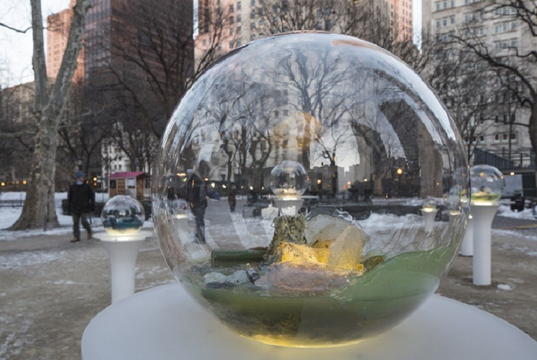 Image: Installation view of 'Gazing Globes', 2015 by Paula Hayes in Madison Square Park, New York as part of The Armory Show 2015