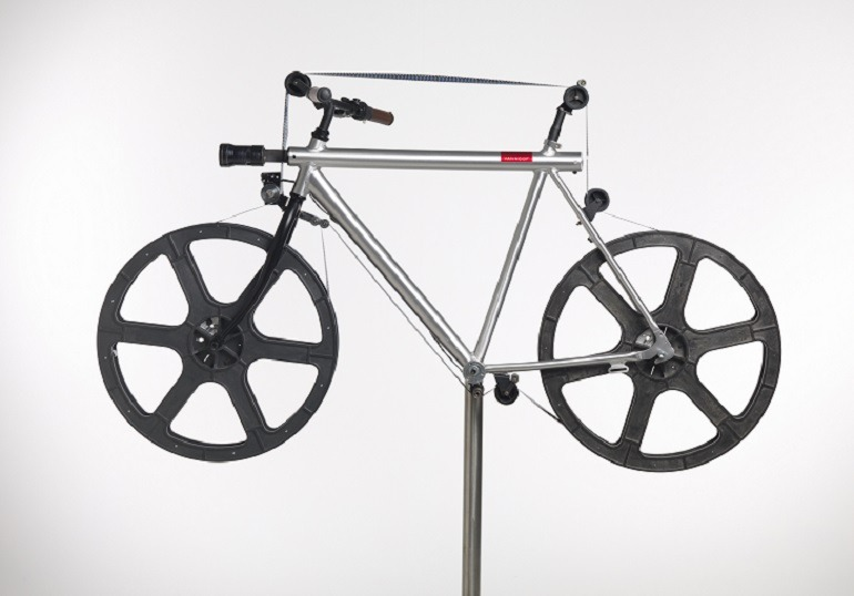 Image: Timothy Smith's  'Velo Cinema 2014', made from  bicycle, colour 35 mm film, projector and electrical components, one of the artworks at the NGV