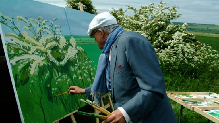 David Hockney at work on one of his paintings