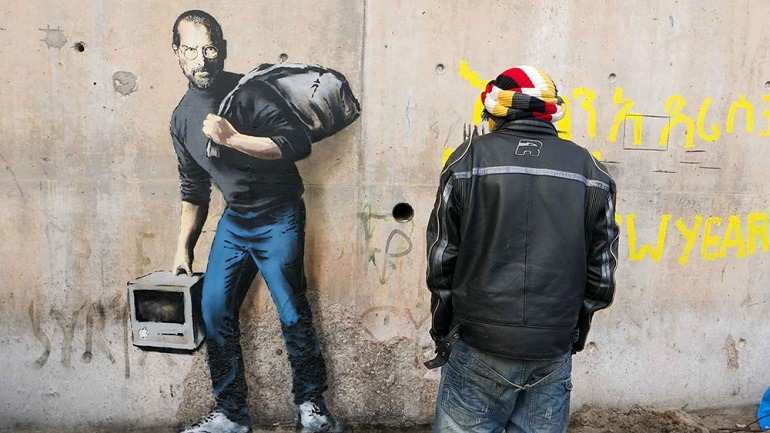 Banksy Highlights Steve Jobs Syrian Root in New Mural
