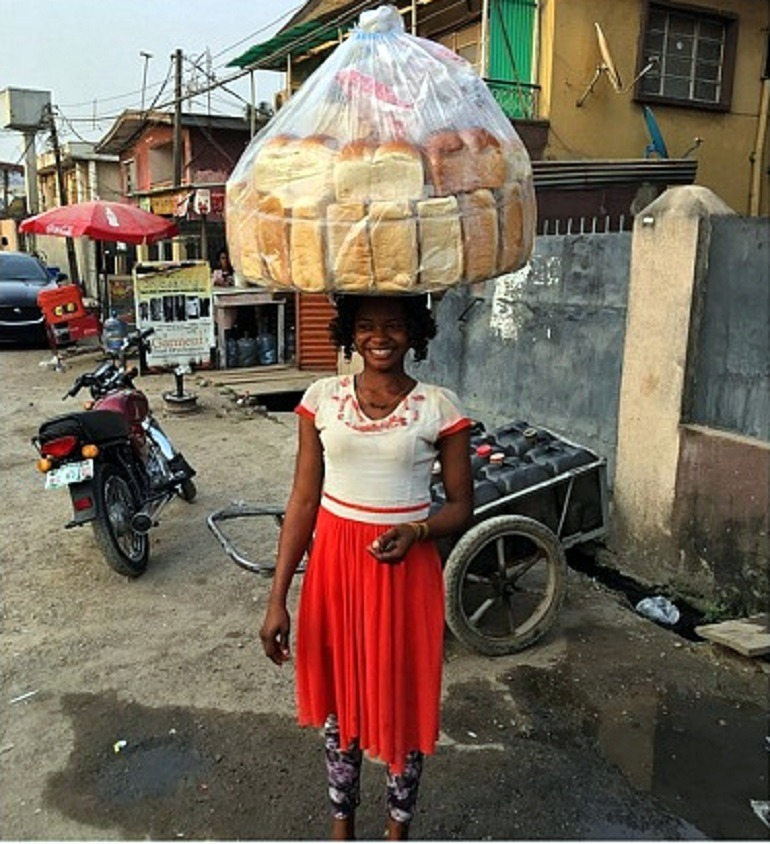 Image: Olajumoke Orisaguna, the bread-seller and woman whose life changed after photobombing pop star Tinie Tempa in Lagos