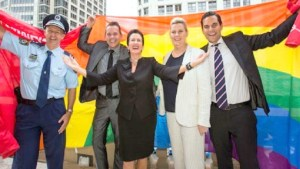 Image: City of Sydney officials Wrapped in the Rainbow Flag, celebrating LGBT RIGHTS