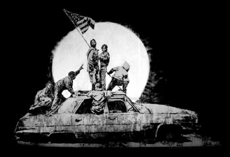 Image: Flags by Banksy, is one of the works on display in War, Capitalism & Liberty in Rome