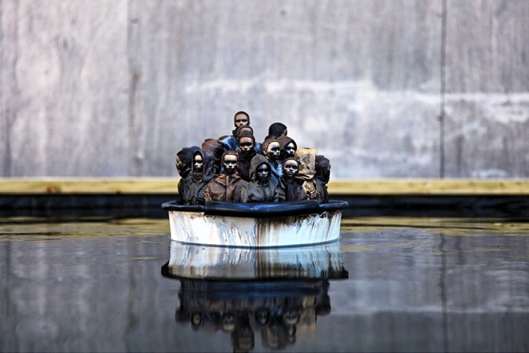 Image: Packed Migrant Boat in Dismaland by Banksy, is an important example of how the artist explores street art and graffiti art to make statements about Migration, war, liberty and other important social issues. Banksy Art