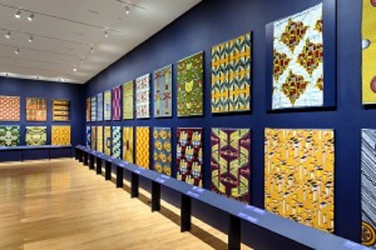 Image: Wax printed fabrics with bold patterns by Vlisco on display at Philadelphia Museum of Art is part of African identity
