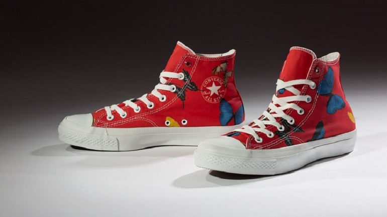 Image: Converse, Damien Hirst (Product) RED is a pair of sneakers with butterflies, a motive extensively used by the artist in paintings.