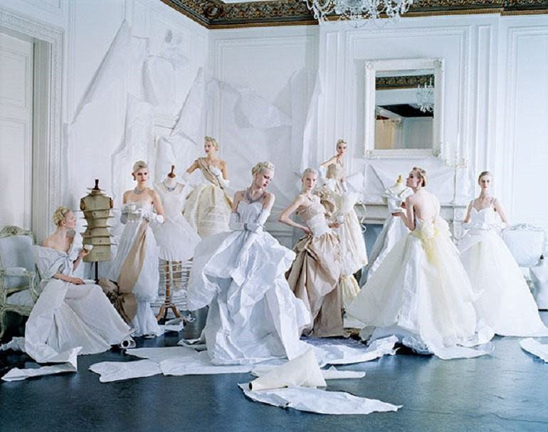 Image: Tim Walker photograph of several models dressed in paper dresses and jewelry created by Rhea Thierstein. One of the famous fashion photographers that worked with Grace Coddington at Vogue