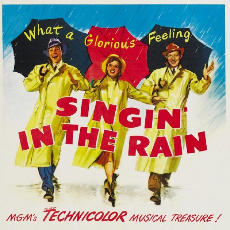 Image: This Singin in the Rain poster shows Gene Kelly, Donald O'Connor, and Debbie Reynolds as they performed in this all time classic
