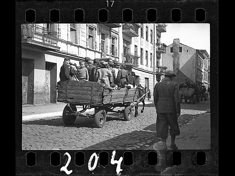 Image: Black and white photograph of Children Being Transported to Chelmno Nad Nerem, renamed Kulmhof, death camp, 1942 by photographer Henryk Ross