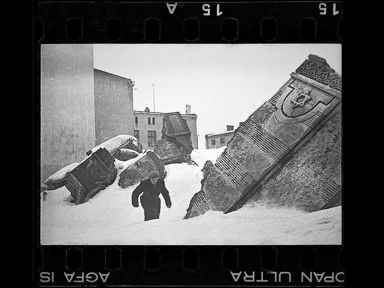 Image: Black and white photograph of Man Walking in Winter in the Ruins of the Synagogue on Wolborska Street (Destroyed by Germans 1939), 1940 by Henryk Ross