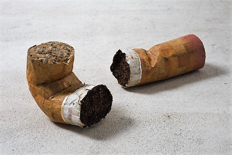 "Image: A sculpture made from Cigarette butts, lipstick, glue titled Mini Colillón Masculino y Femenino by Jesús ""Bubu"" Negrón"