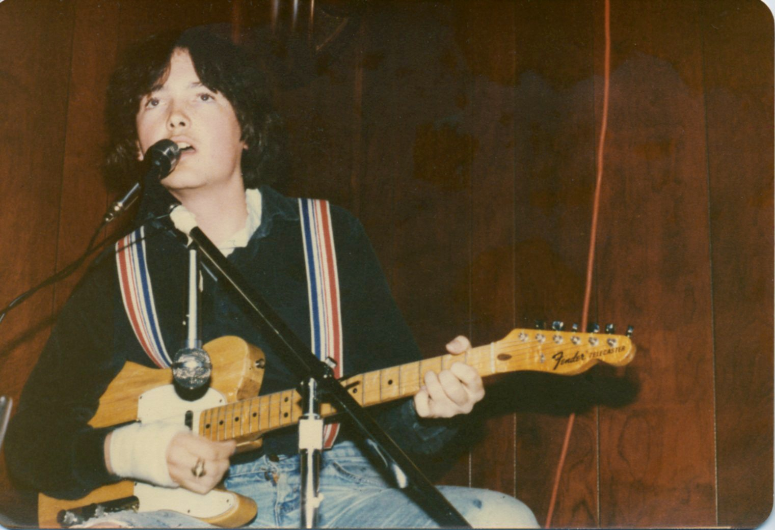 Art Coulson performing at the Student Prince Haufbrau in Durham, NC, in 1980. He is playing a Fender Telecaster guitar and wearing striped suspenders