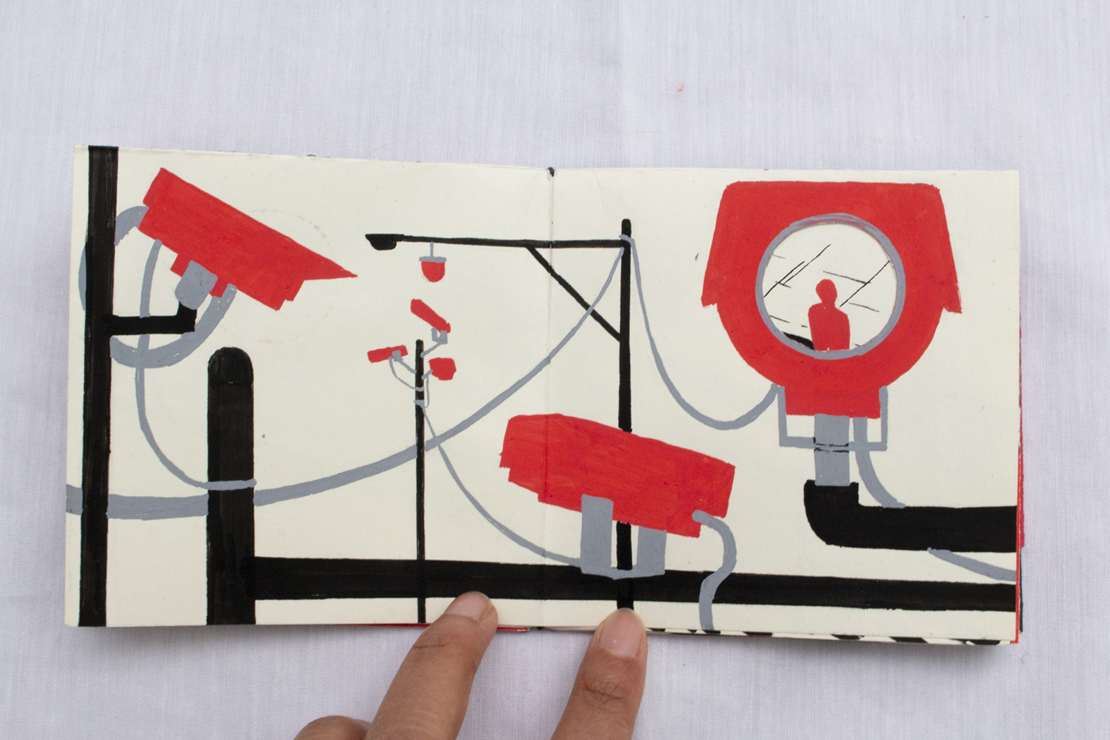 Seventh spread folded. Red surveillance cameras atop electric poles. The largest one has a cut-out showing a red silhouette.