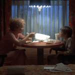 Alice Doesn't Live Here Anymore (1974) | Martin Scorsese production design | Martin Scorsese Films | Ellen Burstyn and son at table eating dinner in front of window in their hotel room