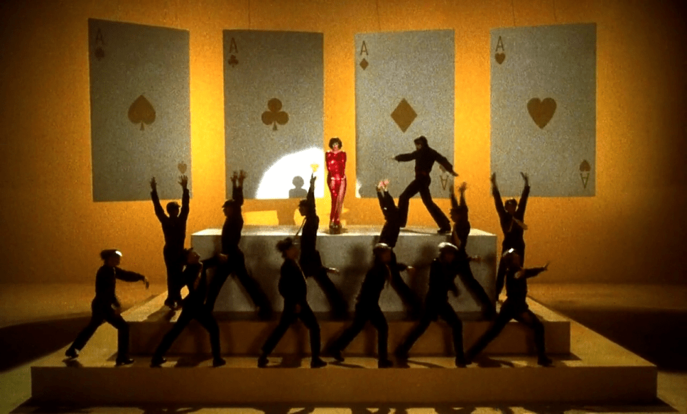 New York, New York (1977) / Martin Scorsese production design | Martin Scorsese Films | Yellow background with stage set up with large hanging playing cards in background
