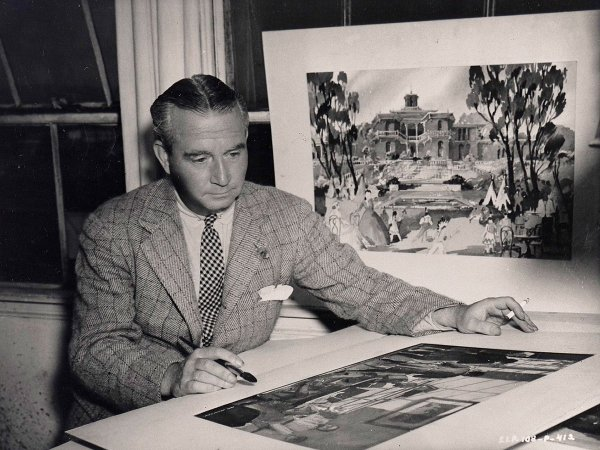 William Cameron Menzies painting at the drawing board