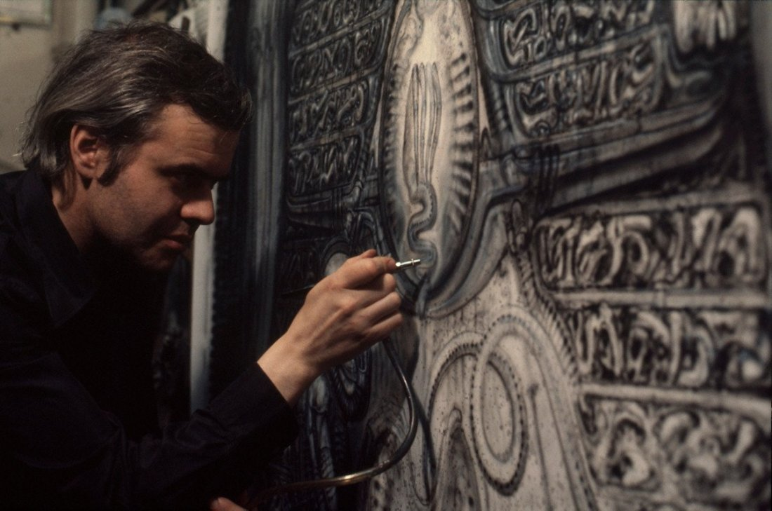 H.R. Giger at work on a painting