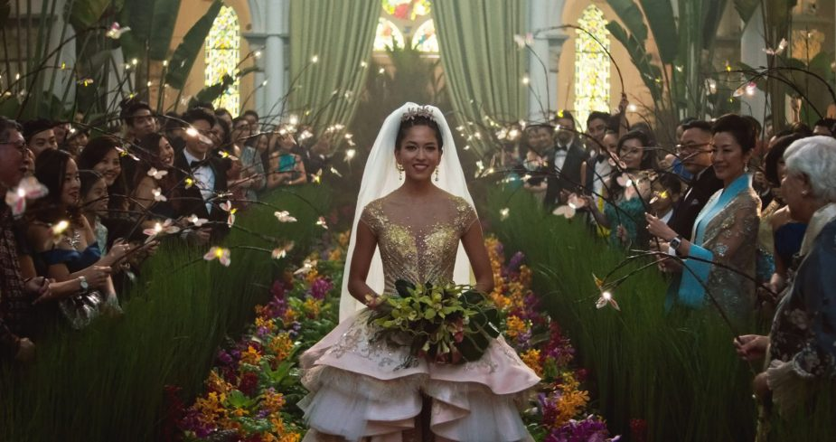 Crazy Rich Asians- 2018 Film- Bride walks down the isle in tall grass, flowers, lily pads and fairy lights- Best Production Design of 2018