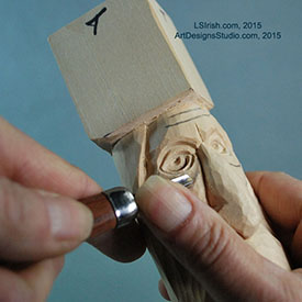 Using a small round gouge in wood spirit carving