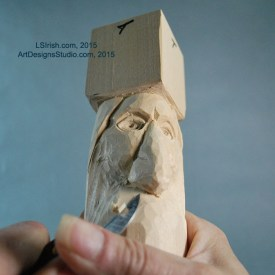 carving the mustache of a wood spirit