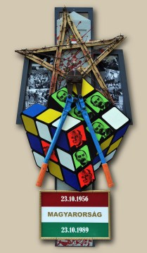 6. terč: 23.10.1989 PÁD ŽELEZNEJ OPONY / MAĎARSKO 122,5x60x10, sololit na ráme, akryl, asambláž / ready-made Politické, vojenské, historické symboly a predmety víťazstva demokracie v Maďarsku 6. ціль: 23.10.1989 ПАДІННЯ ЗАЛІЗНОЇ ЗAВІСИ / УГОРЩИНА 122,5x60x10, оргалит на рамі, акрил, aссамбляж / ready made Політичні, військові, історичні предмети які символізують перемогу демократії в Угорщині 6th target: 23.10.1989 COLLAPSE OF THE IRON CURTAIN / HUNGARY 122,5x60x10, fibreboard on a frame, acrylic, assemblage / ready-made Political, military and historical symbols of the victory of democracy in Hungary