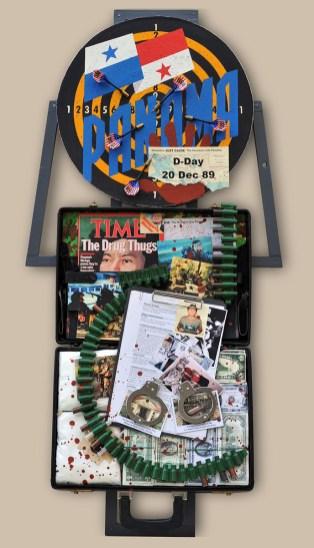 "10. terč: 20.12.1989 ""DROGOVÁ STOPA"" / PANAMA 122,5x60x20, sololit na ráme, akryl, asambláž / ready-made Politické, vojenské predmety a dokumenty intervencie USA v Paname a uväznenie generála Manuela Noriegu 10. ціль: 20.12.1989 СЛІД НАРКОТИКІВ / ПАНАМА 122,5x60x20, оргалит на рамі, акрил, aссамбляж / ready made Політичні, військові об'єкти і документи втручання США в Панамі і арешт генерала Мануеля Нор'єги 10th target: 20.12.1989 DRUG TRAIL? / PANAMA 122,5x60x20, fibreboard on a frame, acrylic, assemblage / ready-made Political and military items and documents of the intervention of USA in Panama and the imprisonment of General Manuel Noriega"
