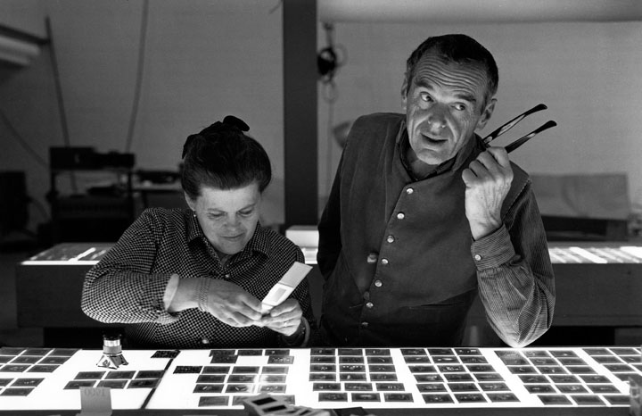 02. An Eames Celebration. Charles and Ray Eames selecting slides. ∏ Eames Office LLC.jpg