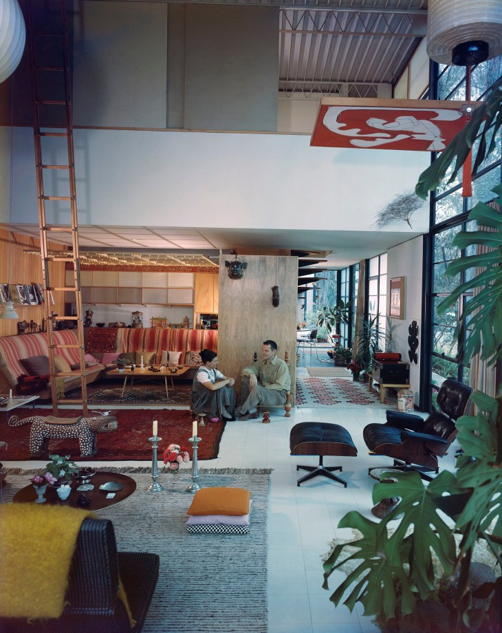 06. An Eames Celebration. Ray and Charles in their living room, Eames House, 1958.jpg