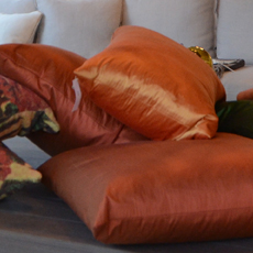 orange pillows and home furnishings in Belmont