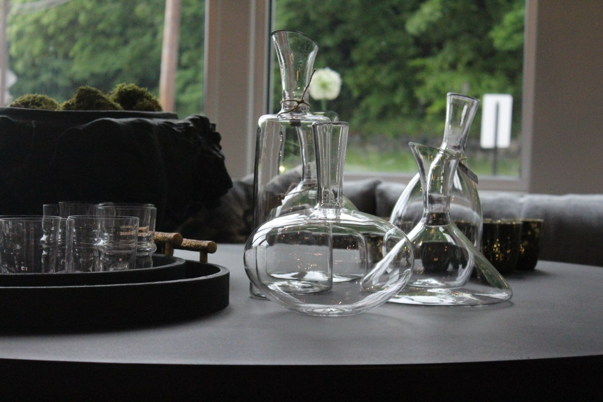Decanters on cement + reclaimed elm table