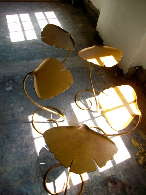 gingko martini tables - hand forged steel gilded with gold or platinum - just one is a statement - grouped or paired for a larger 'table'....i am once again considering 'taking up drinking martinis' - seems like these tables make it cooler than cool