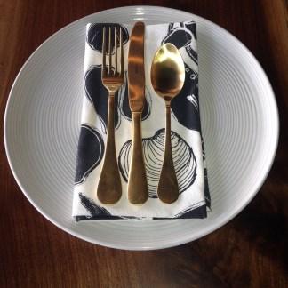 blue seafood tea towel on md plate
