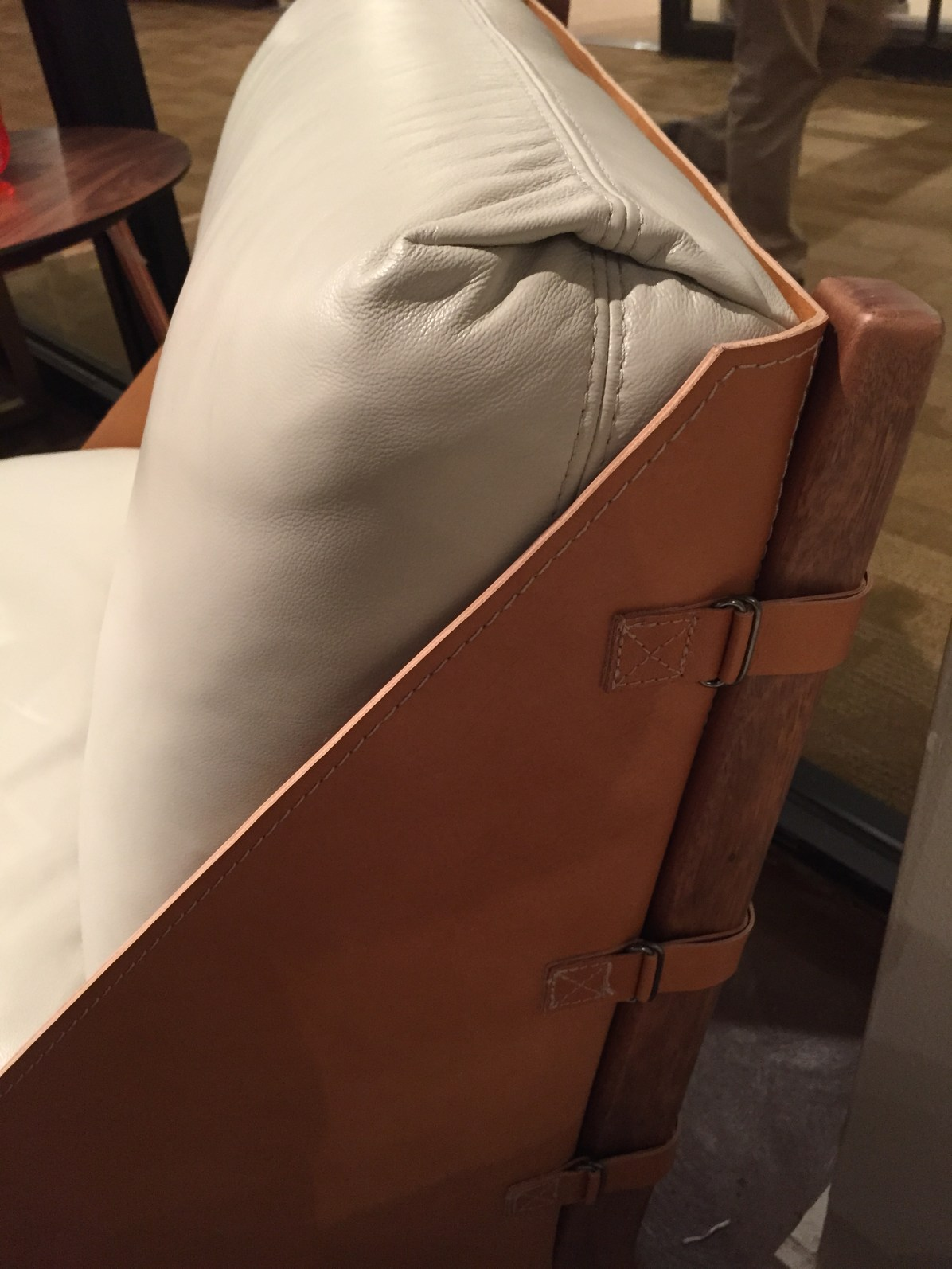the coolest leather chair ever - just one in white leather with natural leather frame