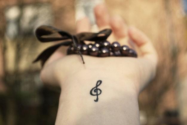 clave de sol tatuaje
