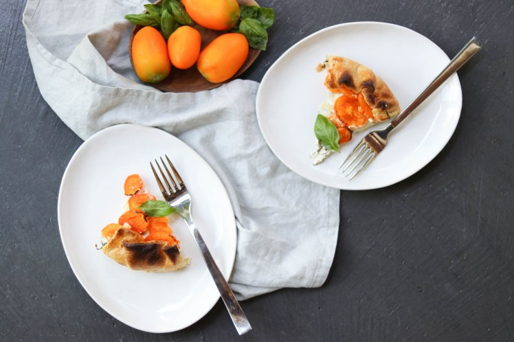 Photograph of table setting with seasonal tomato tart