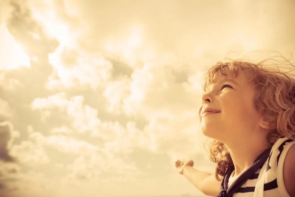Sailor kid looking ahead against summer sky background