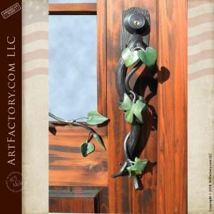 custom French pane glass front door with custom vine door handle