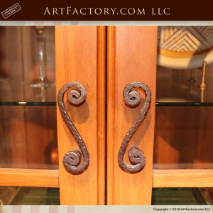 custom exotic wood China cabinet with s-scroll shaped cabinet pulls
