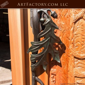 moose hand carved front door with custom oak leaf door handle