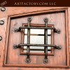 solid wood castle door, iron speak easy grill