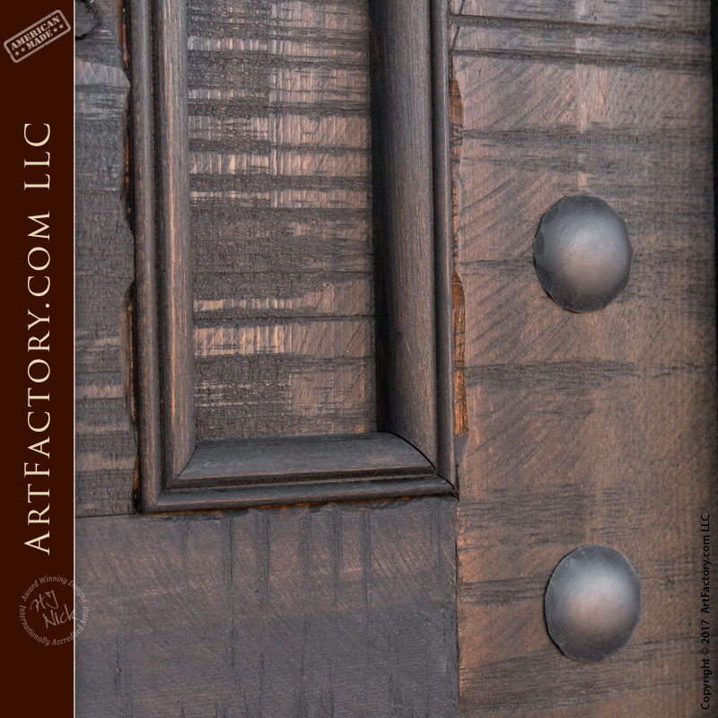 castle style entrance double doors wrought iron clavos