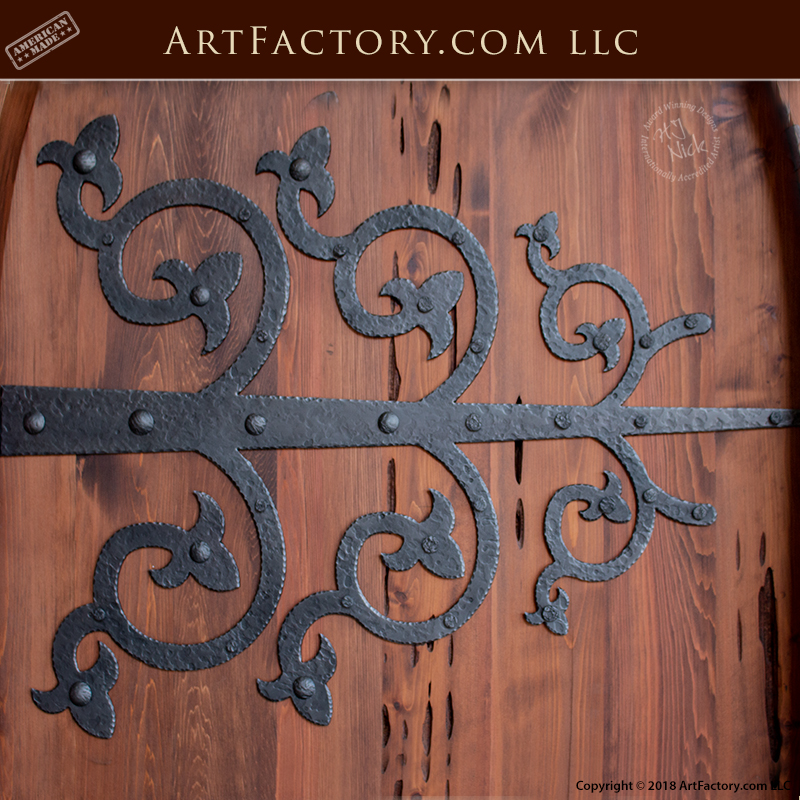 custom cathedral arched door with custom ornamental strap hinges
