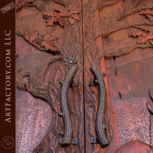 custom oak branch door handles on forest inspired hand carved entrance