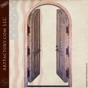 weathered wood double doors in open position