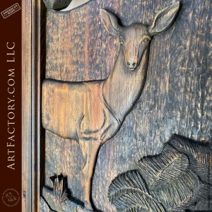 hand carved doe in forest close up