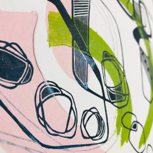 Prints on paper hang on a wall from string. Drying prints - Anne Waggot Knott